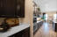 Coffee or Wine Bar leads between Kitchen & Dining