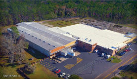 Recently renovated Industrial Warehouse space with 120,100 square feet boasts 2 dock high doors with 5 additional grade level doors. A two story professional office connects to the warehouse space allowing for additional onsite staff. A few spaces are already built out on the main warehouse floor to include a large conference/ meeting room, mezzanine, and a couple of designated production areas. This space lays out nicely and is ready for immediate occupancy. Additional 2 + acres of fenced in yard space also available for purchase.