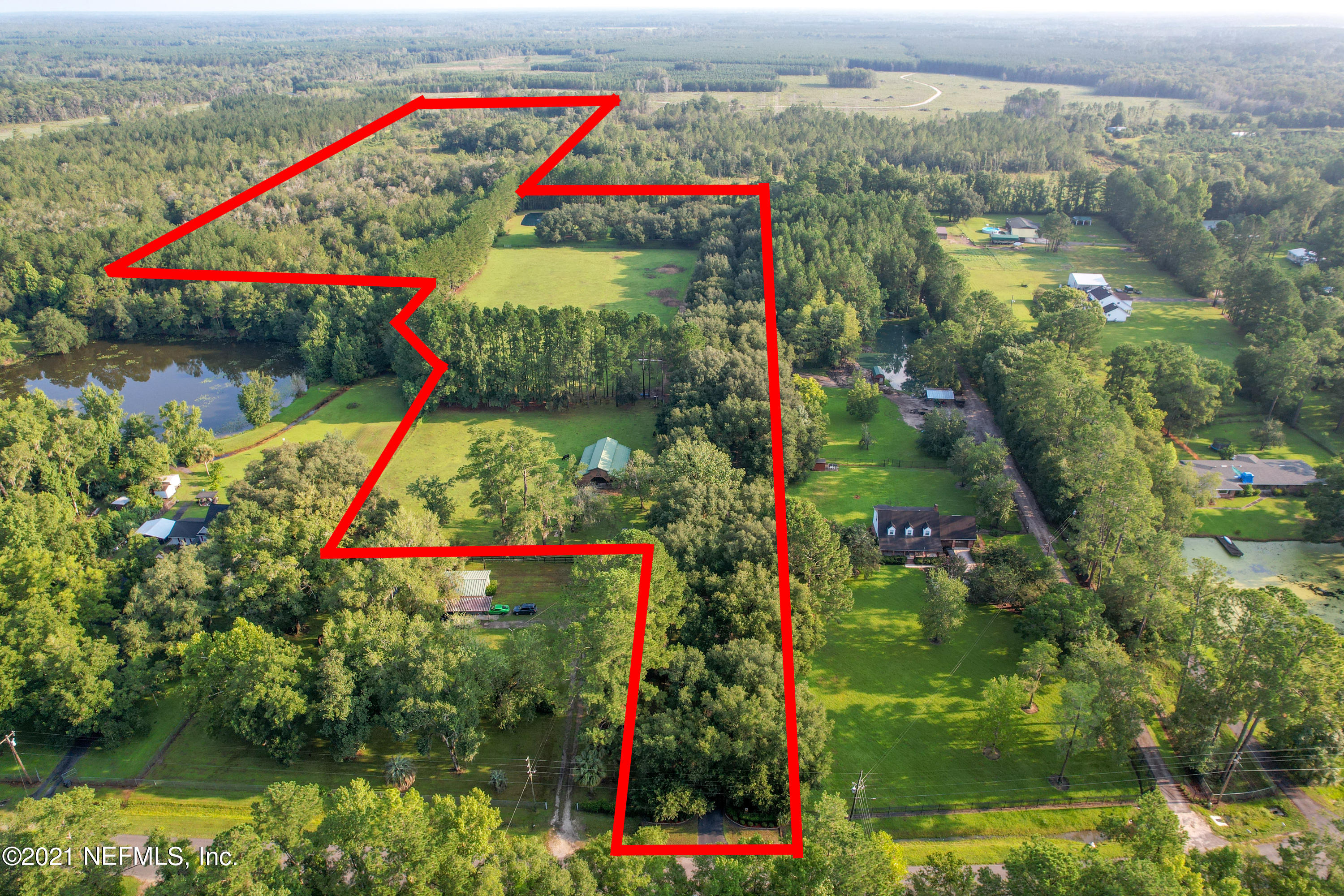 """Ranch living at its finest!  40+/- Acres!   Private gate greats you and opens up to the Canopied driveway of Oak Trees.  Feels like the entrance of a movie!  Must see video!  10 Acres cleared with manicured lawns and fenced-in pasture with barn.  All brick main home greets you with a picturesque front porch and custom picnic table included.  2,681 Sq Ft, fully updated and boasts 3 bedrooms, 2 baths.  Large vaulted living room with wood floors greats you welcoming home.  Large custom kitchen, Granite counters and updated SS Appliances.  Extra kitchen eating area, bar area and pantry.  Wood floors in all bedrooms.  Master Bath features exotic tile work, tub and dual sinks.  Private office with separate entrance.  Step out back and take a dip in the glistening pool.  Just beyond the pool Just beyond the pool is the all brick """"Pool house"""" with 696 Sq Ft.  Features a 1/2 bath, wet bar, pool table, living space and beautiful wood walls.  Roof 2019 on both buildings.  Separate Mother in law suite (fully furnished) contains a living room, kitchen, dining room, bedroom, 2 full bathrooms and laundry room; could be rented short term or long term.  Next to the apartment is a heated and cooled craft room.  This could easily be converted to another bedroom or keep it as is, storage or workshop.  This building shows 2028 Sq Ft, per the property appraiser site.  The oversized garage is located in the back of this building.  The remaining 29+ Acres is mostly wooded with a trail around the property.  3 Covered areas and targets set up for long range shooting.  Custom pond with liner backing is stocked with Talapia, Carp, Brim and Catfish. The OR zoning permits the owner for many uses.  The possibilities are endless!  Ask for the OR Zoning Permitted Uses, you'll be shocked at your options. There are two donkeys (Mom Chole and daughter Clementine) very kind and loving, they love interacting with humans.  Their favorite snack is a carrot.  Cinco is a miniature horse and was born on Cinc"""