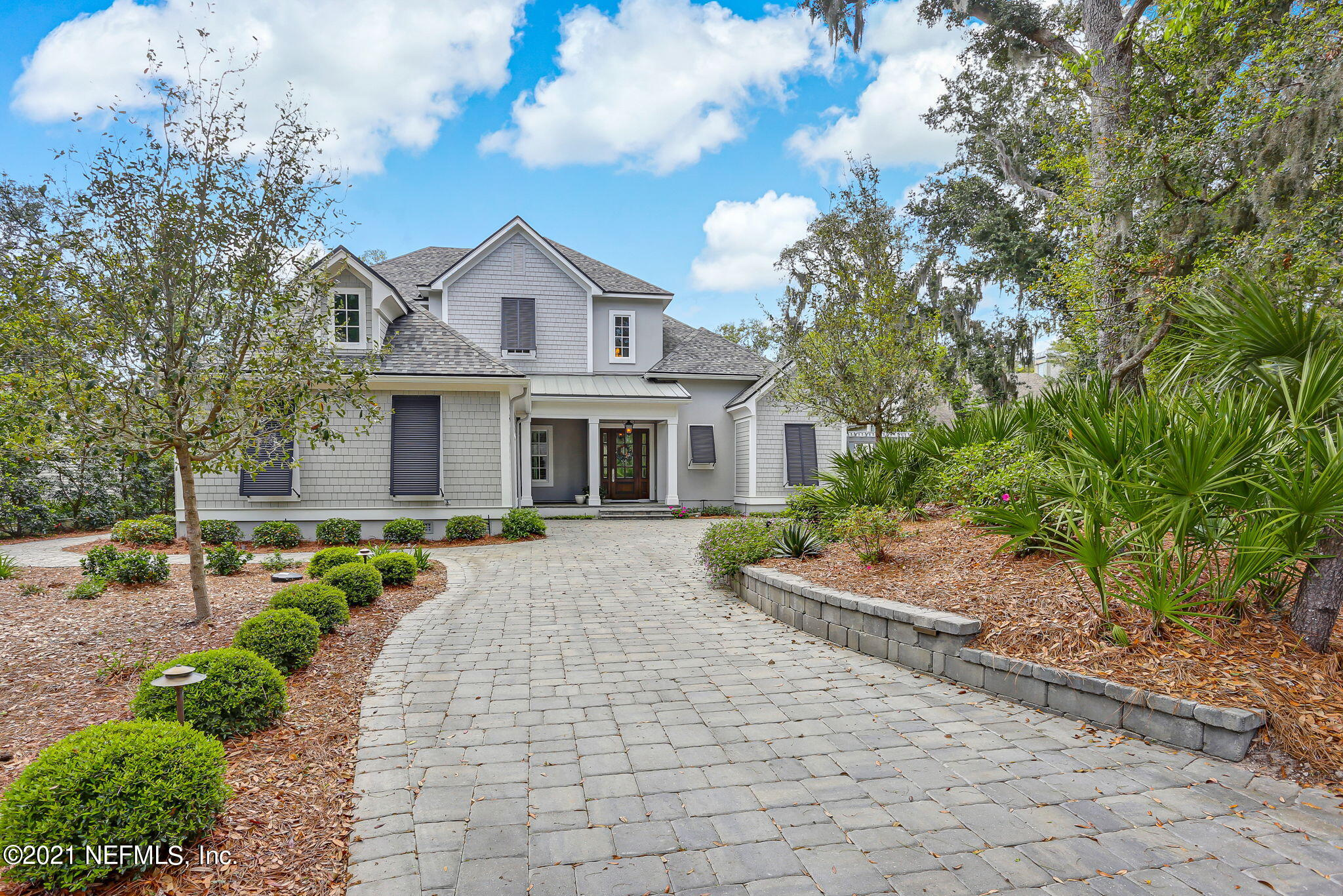 A beautiful, 4,000+ square foot home inside the Amelia Island Plantation that was custom built just for you. Enjoy views of the Oak Marsh Golf Course from the comfort of the private screened in lanai with inground saltwater pool, heated spa, outdoor fireplace, and outdoor grill area. Notice the quality in every detail from the custom European oak wood flooring to high ceilings to high end appliances and private baths with each bedroom. Entertaining is a breeze with a bonus room with a wet bar upstairs overlooking the golf course and an additional wet bar and wine room downstairs. Plenty of space for all of your beach toys and golfing necessities in the 2-car garage and separate bay for golf cart storage. Looking for unique features and luxurious upgrades? You've found it.