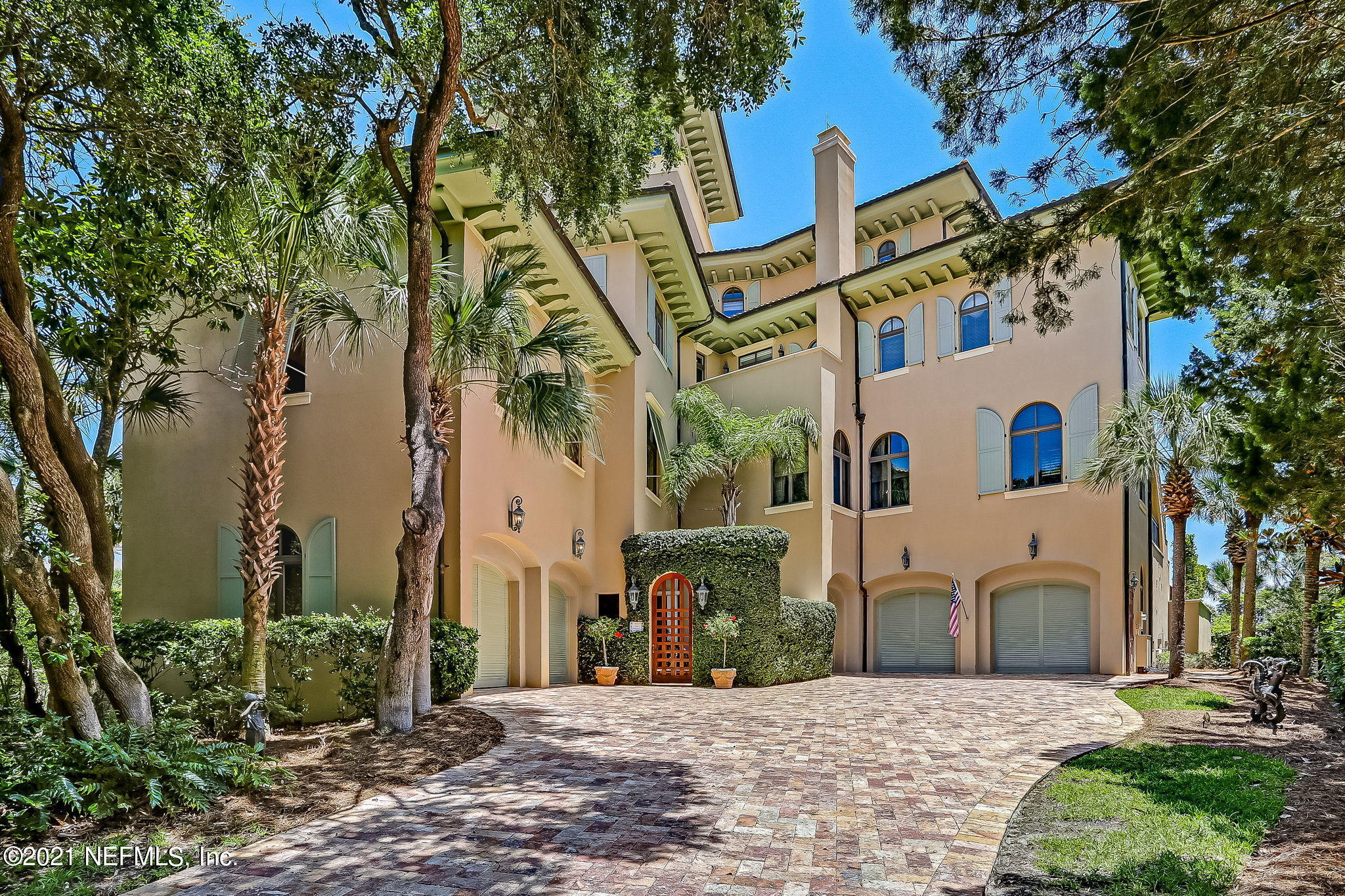 Reminiscent of an Italian villa, this is a modern take on Italy's most enviable architecture. Hand-crafted Walnut columns and beams open up to a great room with floor-to-ceiling windows and sweeping ocean views. This home is rich in details, from a soaring spiral staircase to a 5th-floor Crow's Nest with 360-degree views. Boasting 5 master suites, all with views of the ocean, and walk-in closets, families thrive here. A Tuscan-style kitchen invites the most esteemed chef with cutting-edge appliances, and a 4th-floor primary suite featuring hand-troweled Venetian plaster walls caters to the owners with breathtaking morning views. Outdoor oceanfront terraces, accessible from each floor, overlook a double infinity pool. From the exterior, a travertine driveway leads to 4 oversized garages. Just steps away within the Ocean Club Drive community, the Amelia Island Club's Ocean Clubhouse provides an amenity package that is sure to please.