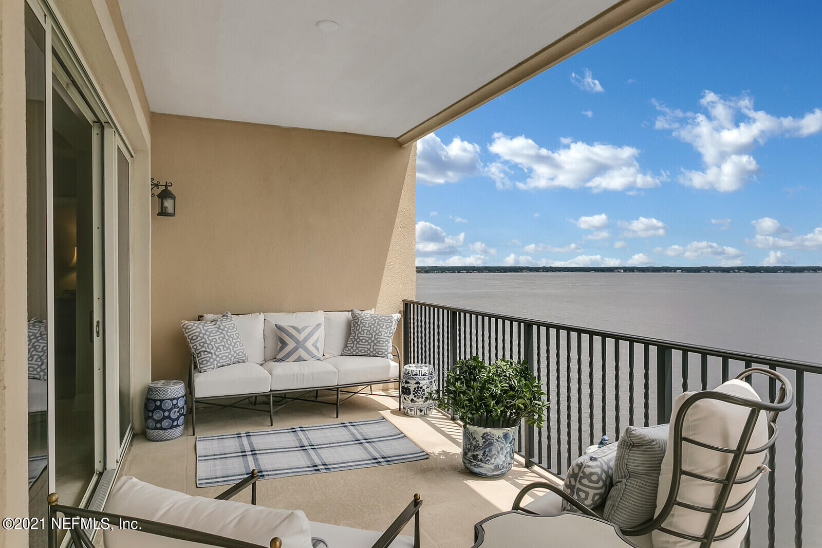 Looking for the perfect birds eye panoramic view of the St Johns River, settle in on the 10th floor for spectacular sunrises and sunsets on your spacious private terrace. Open floor plan from kitchen to family room with great views. Kitchen has upgraded GE Appliances including double ovens, natrual gas cook top, side by side refrig. and center island with granite counters, . Family room has a gas fireplace for  cozy cooler weather . Main living spaces have travertine flooring and all other rooms have brand new seagrass carpeting. Entire unit freshly painted and all new lighting fixtures. 9''8''' ceilings , Owners suite has water view, huge his and her closest and large en suite bath.  Each bedroom has it's own bath. A rare two car garage comes with this unit. Tons of closets and two storag closets . The amenities include a beautiful lap pool on the river, massage room, fitness center, guest suite and elegant lounge room overlooking pool with bar for personal entertaining. Very private and secure with gate and multiple codes for entrance.