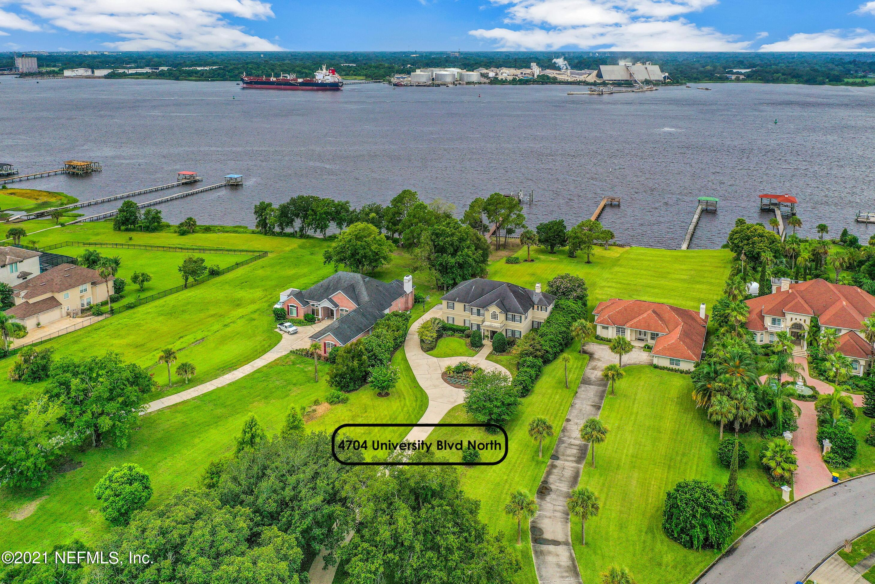 """Prepare to be CHARMED... southern charmed by this elegant & inviting RIVERFRONT custom-built beauty. Perfectly nestled down a winding driveway this home sits on over an acre & a half w/mature trees, lush landscaping & a sensational lawn running down to the river w/100 feet of water front, a new dock, & reinforced bulkhead all overlooking wide views of the St. Johns River...Boasting too many beautiful design features to mention, from the hickory hardwood floors, custom crown moldings, 10' ceilings, endless windows, & wood-burning fireplace, to the impeccably updated chef's dream custom kitchen seamlessly connected to the spectacular dining room & warm & inviting family room all w/endless river views..this home is a MUST SEE. Minutes to downtown, premier shopping, restaurants, & schools. As you drive down the palm-tree lined entrance to Rive St. Johns you'll know you've found a hidden gem in this picturesque riverfront community. Elegant & inviting this Kevin Gray Design Group custom-built riverfront home is built to perfection. Boasting over 3,800 square feet this 4-bedroom, 4 bathroom home is the epitome of Florida living overlooking wide views of the St Johns River. Step inside and you're welcomed HOME w/beautifully updated 6"""" wide Naturally Aged hickory hardwood flooring, rich-colored walls & the two-story foyer w/sweeping staircase, all as you peer down the hallway to the warm and inviting family room with RIVER views everywhere you look. Step into your dream custom kitchen boasting a Viking 36"""" built-in cooktop, vented range hood, above-cabinet up lighting, classic white subway tile backsplash, S&S Design custom wood soft-close cabinets, Pompeii Misterio Quartz counters, Kitchen Aid double-oven featuring convection micro/oven combo and 42"""" GE Monogram built-in refrigerator w/integrated cabinetry. The kitchen will be the perfect gathering place, around the island, at the eat-at counter or sitting down for a quick bite at the eat-in nook, all while enjoying river """