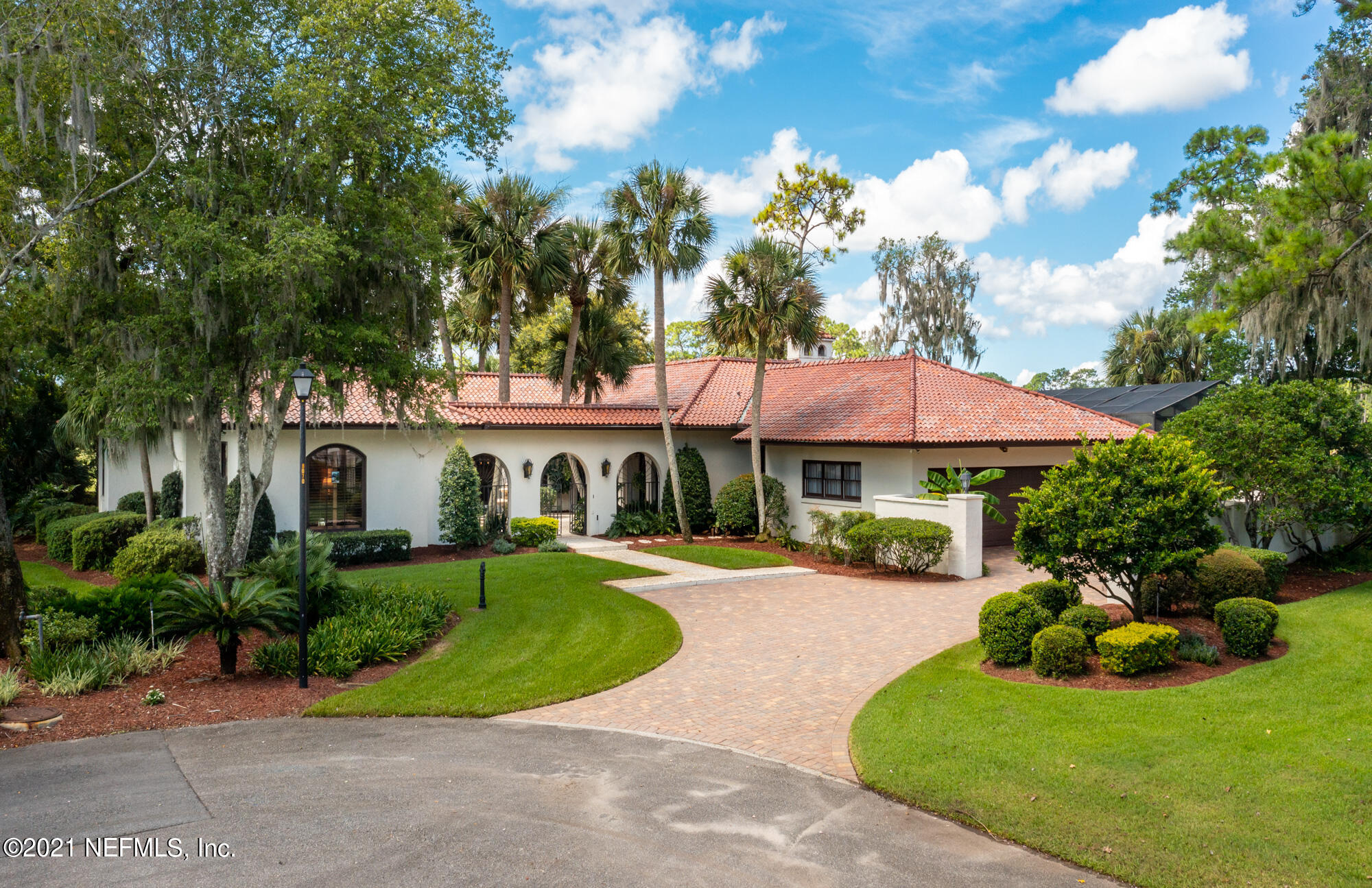 """***MULTIPLE OFFERS HIGHEST & BEST due by 9.10.21 7P.***A golf course ''mini'' estate home unlike any other in Deerwood Country Club. Situated on 2 separate parcels (one of them buildable) on a private cul-de-sac, you will feel as though you are in a world of your own! Upon entering the Spanish style courtyard adorned with a water feature, stoned paved walkway and breathtaking architectural arches, you will be transported to an entirely different place and time. It is all in the details, rounded archways, hexagon terra-cotta tiles from Mexico throughout, custom hand painted tile work in the entryway, wood beams vaulted ceilings, and built in book shelves, to name a few. This home was meant for hosting, with 2 large living spaces, a massive dining room, multiple outdoor living spaces. Did we mention....the MULTIPLE golf views  and lake views from almost every room? This home is waiting for a new owner to come and make their own family memories. Do not miss this unique opportunity.  Pool heater being sold, """"AS IS"""". The Primary suite and Dinning Window Treatments do not convey."""