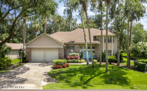 This beautiful home is nestled within the prestigious gates of Sawgrass Players Club.
