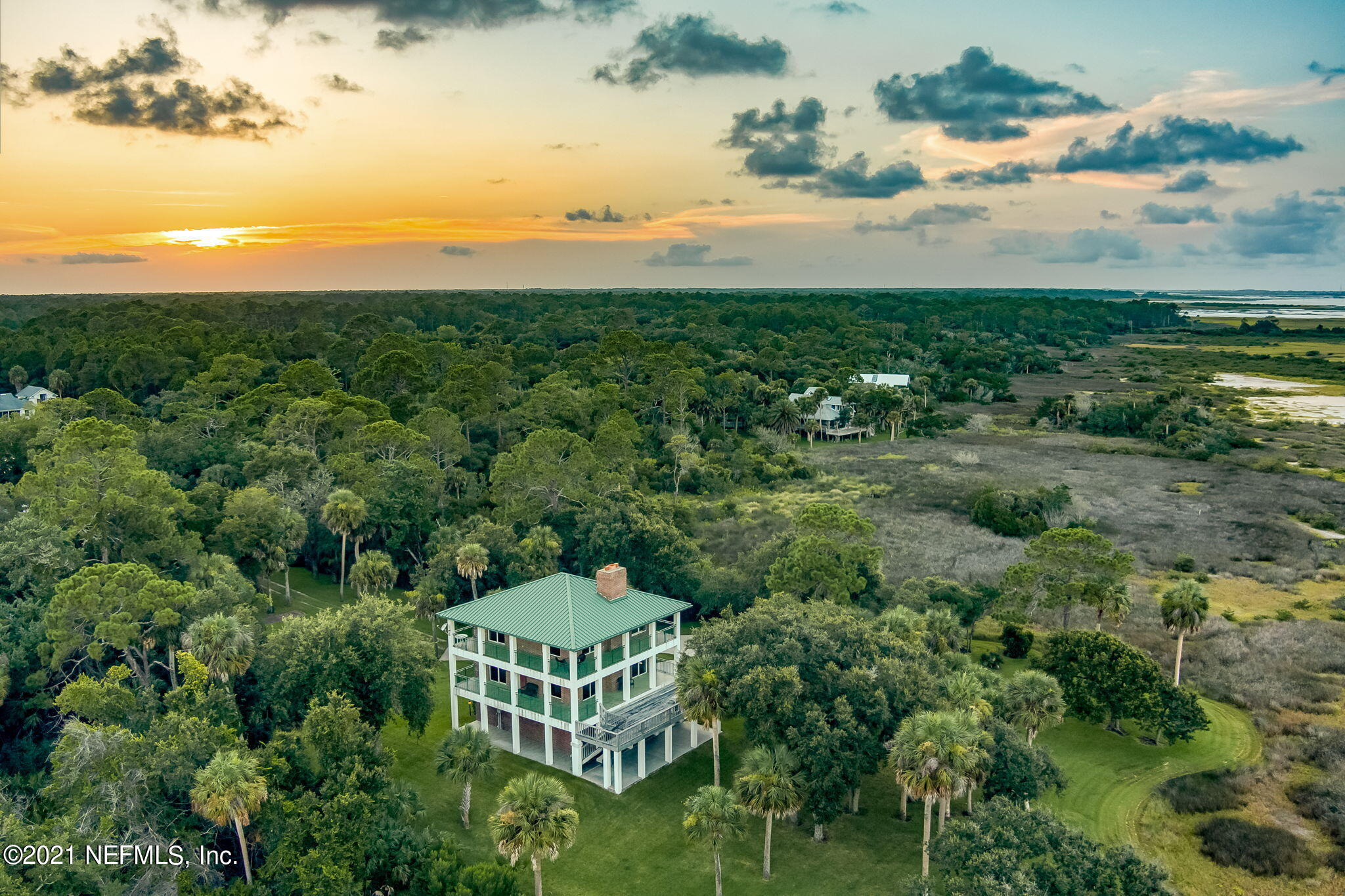 6.5 acres of solitude. A peaceful retreat on the shores of the Matanzas river bordered by ICW marsh front and the Matanzas St. Forest. Natures best is viewed from most every window in this amazing property. Nestled in an enclave of large parcel properties, this is a rare find and a very unique offering. The property includes a 3 story masonry/brick home that boasts views from every window. 2 Bedrooms and 4 baths in this secluded getaway. 2 large oversize garage spaces in the house plus a heated and cooled custom garage/barn for the most discriminating car aficionado or wood worker hobbyist. The barn has closed cell foam insulation under roof to add to its high degree of insulation. Concrete block/brick veneer pump house and storage shed match the façade of the home for architectural continuity. There are many upgrades and features to this property so please view the attached documents. Also, attached are the survey and the elevation certificates. A private lake and some wetlands add to the privacy and attract abundant wildlife including eagles, osprey, deer and otter. An electronic gate adds to the security of your property and keeps unwanted guests away. Deep into the forest off State Road 206, there is virtually no outside noise except for the sounds of nature as you sway peacefully in your hammock that you will place on the deck facing the Intracoastal Waterway for a morning sunrise or afternoon respite.