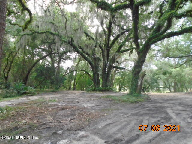 Here is your chance to build your dream home. 5.69 acres on marsh and navigable water. Home has been torn down. Seller is in the process of completing boundary, topographical and site plan to revert the property back to the original 4 lots. The information will then be sent to the Appraisers office to create 4 separate parcel numbers. You can purchase the 5.69 acres or  buy per lot when all is complete which shall be in the next 2 weeks. Buyer to verify all information with the city per due diligence. Lots will vary in price when completed. Land as it is now has 390 ' frontage and 370' depth.
