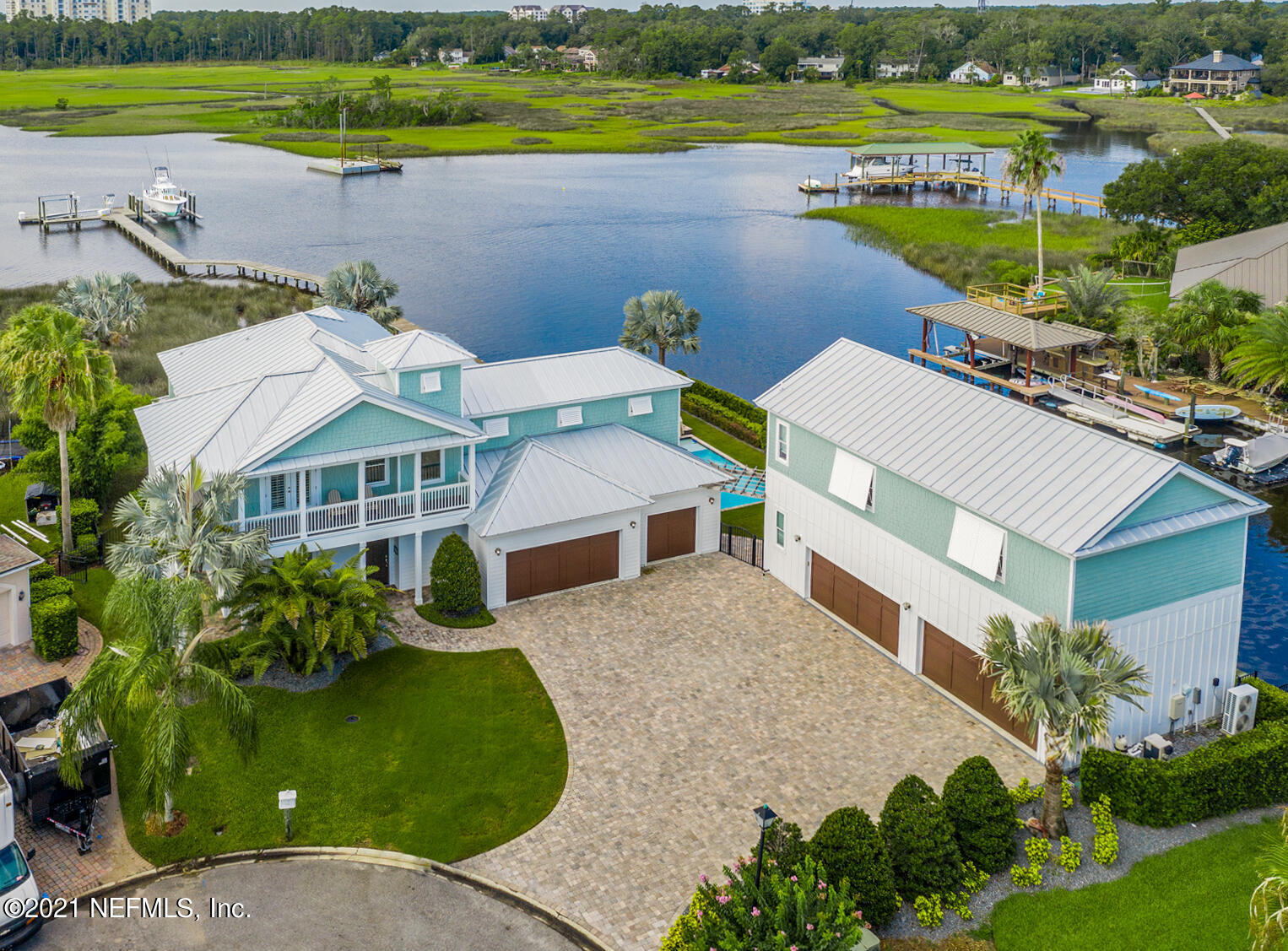 Enjoy Luxury & Location you deserve from Sunrise To Sunset in this Stunning Waterfront Masterpiece. This Warm & Welcoming Home Features Tons of Upgrades including a Gourmet Kitchen, European Oak Hardwood Floors, & Amazing Finishes with Coastal Design & Charm, centered on Functionality & Quality Craftsmanship. Vacation Year-Round with an Incredible Coastal Lifestyle with Professional Landscaping. Entertain from your Summer Kitchen Overlooking the Mediterranean Inspired Heated Pool & Spa, Private Beach Area & Fire Pit. This One-Of-A-Kind Resort-Style Oasis includes Top Amenities like Deep Water Access & Docking for your Largest Yacht, Dream Space for your Car Collection in the 7-Car Garage Layout & a Professionally Equipped Gym. Must See Comprehensive 'Amenities List' to Truly Appreciate.