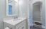 Vanity and tub/shower in full bathroom