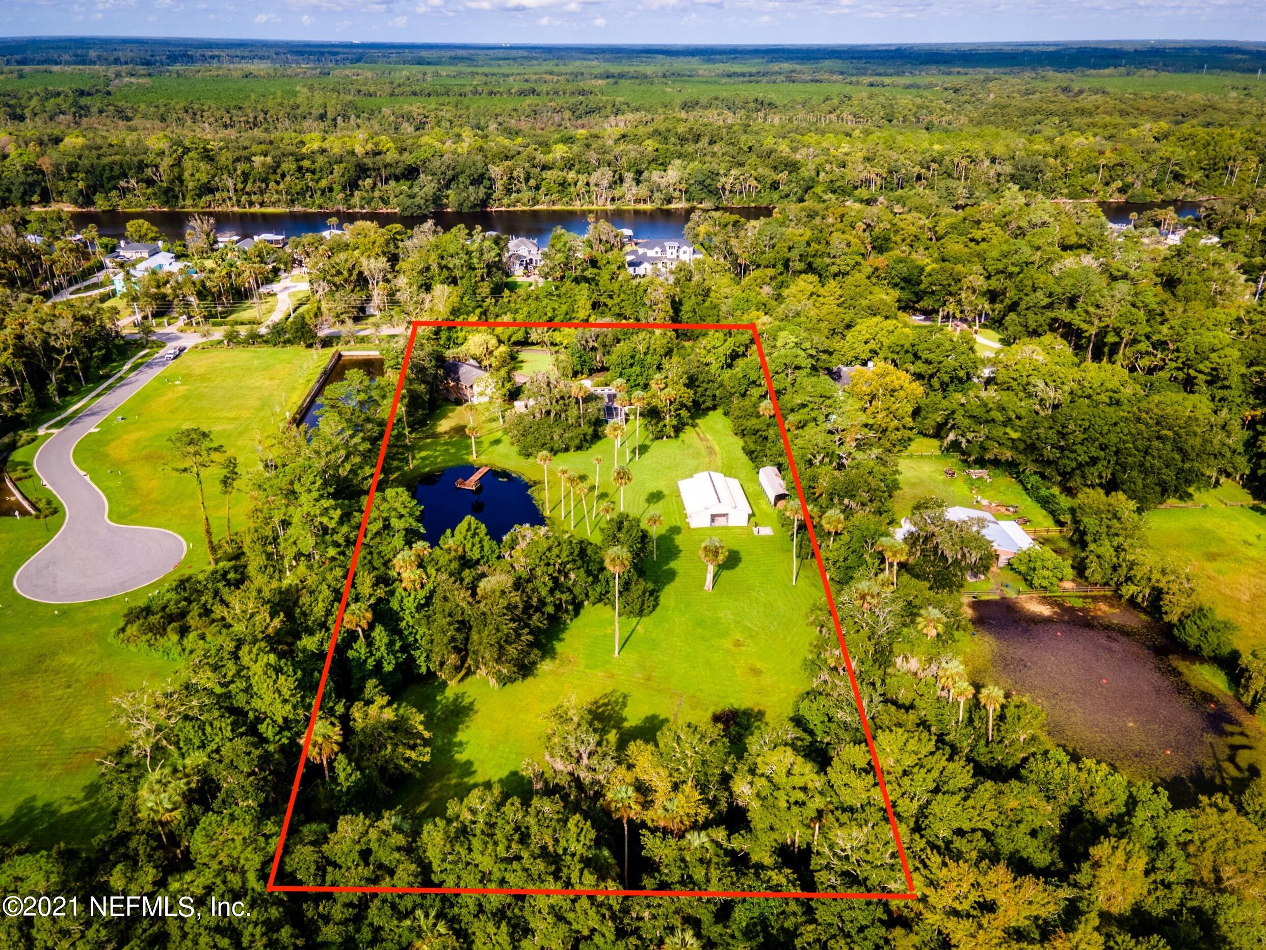Rare 5 usable acres on Roscoe Blvd consisting of two separate deeded parcels. Beautiful property which can be developed into 4-6 lot community, a multi-family home estate or perhaps a horse lovers dream estate located just minutes from Ponte Vedra Beach. The northernmost parcel consists of four acres with a 2556 sf home with 2 bedrooms & 2 full baths plus pool. The southernmost is a one acre parcel with a 2450 sf home built in 2000, consisting of 4 bedrooms & 2 baths. Prior owner loved horse & their family constructed two homes and in the middle north portion of this property lies a barn with 3 stalls but can accommodate up to 6 horse stalls. There is a pond positioned on the southern side of the parcel.  Property is also gated.