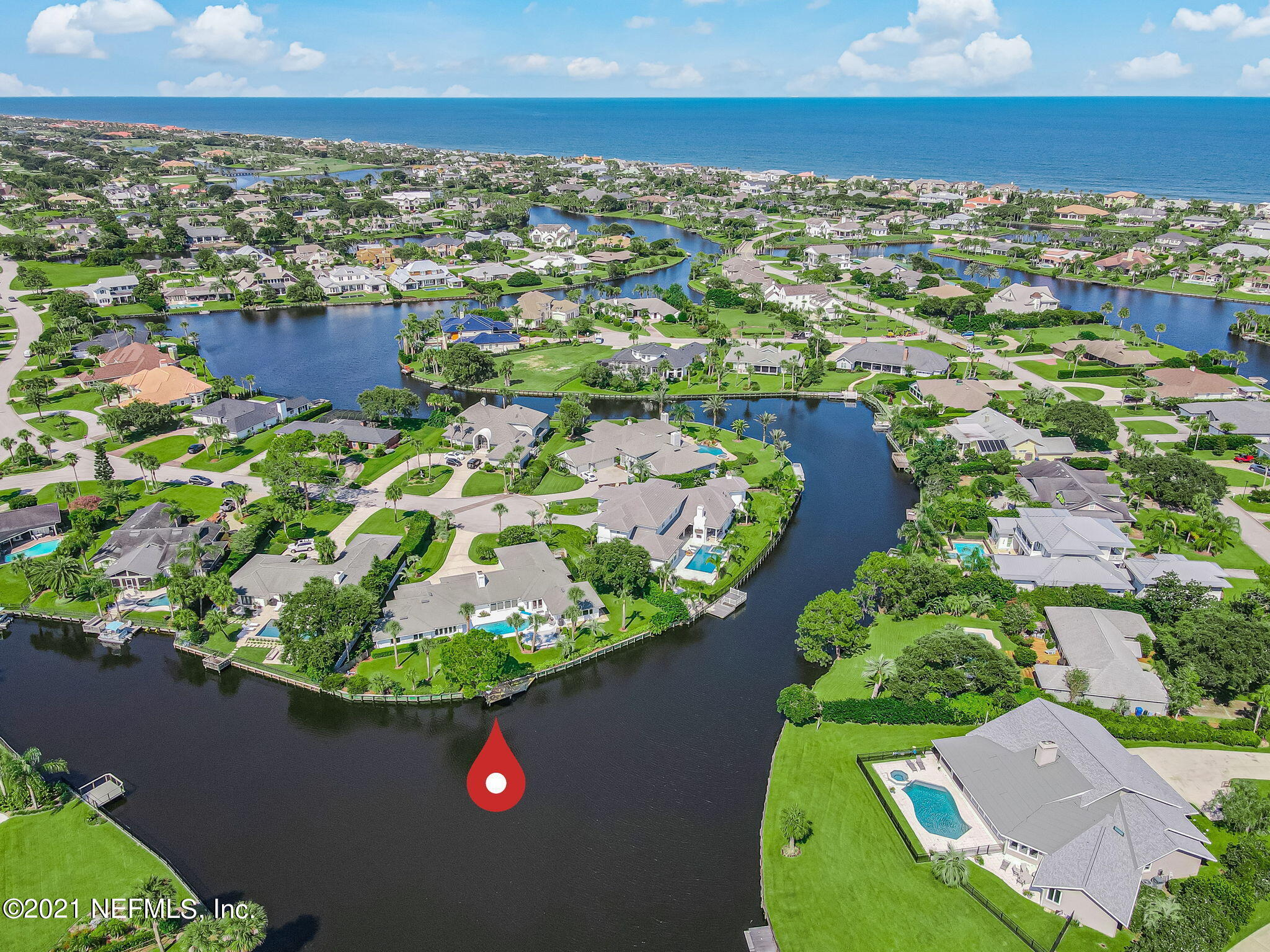 Spectacular waterfront renovated pool home in Old Ponte Vedra Beach! It's hard to take your eyes off the magnificent view. This property anchors the large part of the lake, where it splits 3 ways, so your panoramic water views are 180 degrees. This one-story home is move-in ready, with updated bathrooms, kitchen, flooring, and many windows and doors (rear of the house is all Andersen). These owners designed a fantastic private office with built-ins. In addition to the 5 bedrooms, this home provides formal living & dining rooms, 2 family rooms, huge laundry/storage room. 200' bulkheaded waterfrontage gives the feeling of being on an island. The pool is great for laps and fun, and it's surrounded with 450sf of deck. Roof, HVAC, water treatment & heater 10 years old or less.