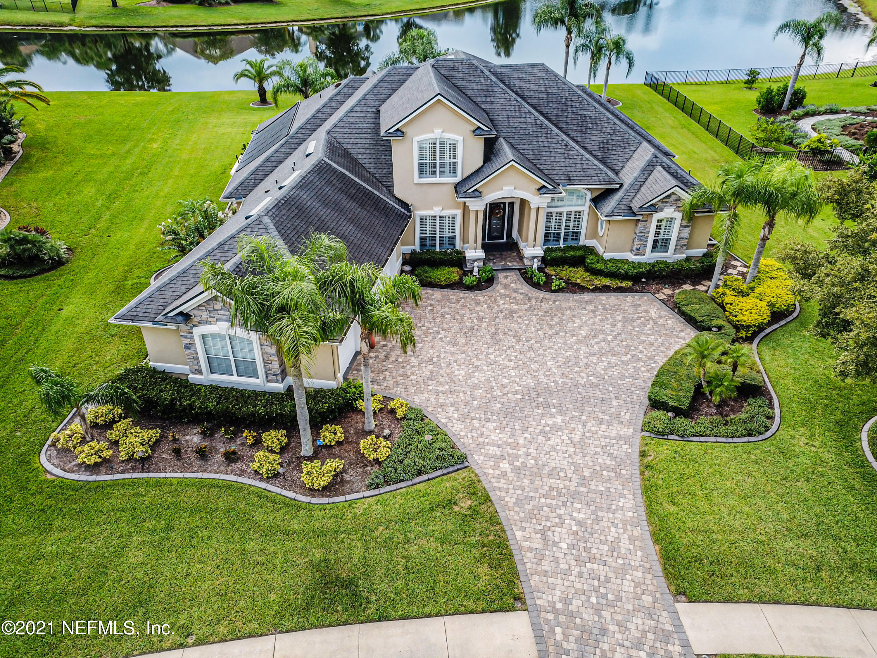 ''There's no place like home.'' That's how the saying goes, and it rings true with this one of a kind home in the sought after community of Bartram Plantation. Boasting more than a half acre lot with a beautiful lake view over the screened in pool, it truly has everything. From the private guest suite upstairs with adjoining bonus room (mother in law suite), to the main floor master bedroom suite with direct patio access separated from the guest bedrooms with jack and jill bath. From the time you walk in you look forward to finding out what's around the next corner. The main floor from front to back includes a formal dining room, office with french doors, Master bedroom, pool bath, living room, Kitchen & Family Room combo, pool view breakfast nook, & guest bedrooms with jack and jill bath. The laundry and drop area connects the oversized 3 car garage to the home. The stairs lead up to a full bathroom, guest bedroom with vaulted ceilings, and extra large bonus room with walk out balcony. The Patio and Pool area is the true focus of the home and is sure to make lots of memories with friends and family. There's a nice sized covered area to enjoy the afternoon thunderstorm out of the rain. The decking is paver with a crystal blue color of the extra large swimming pool. All of this inside a well built screen cage.