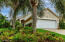 Poured Concrete Walls and Coquina Exterior Finish