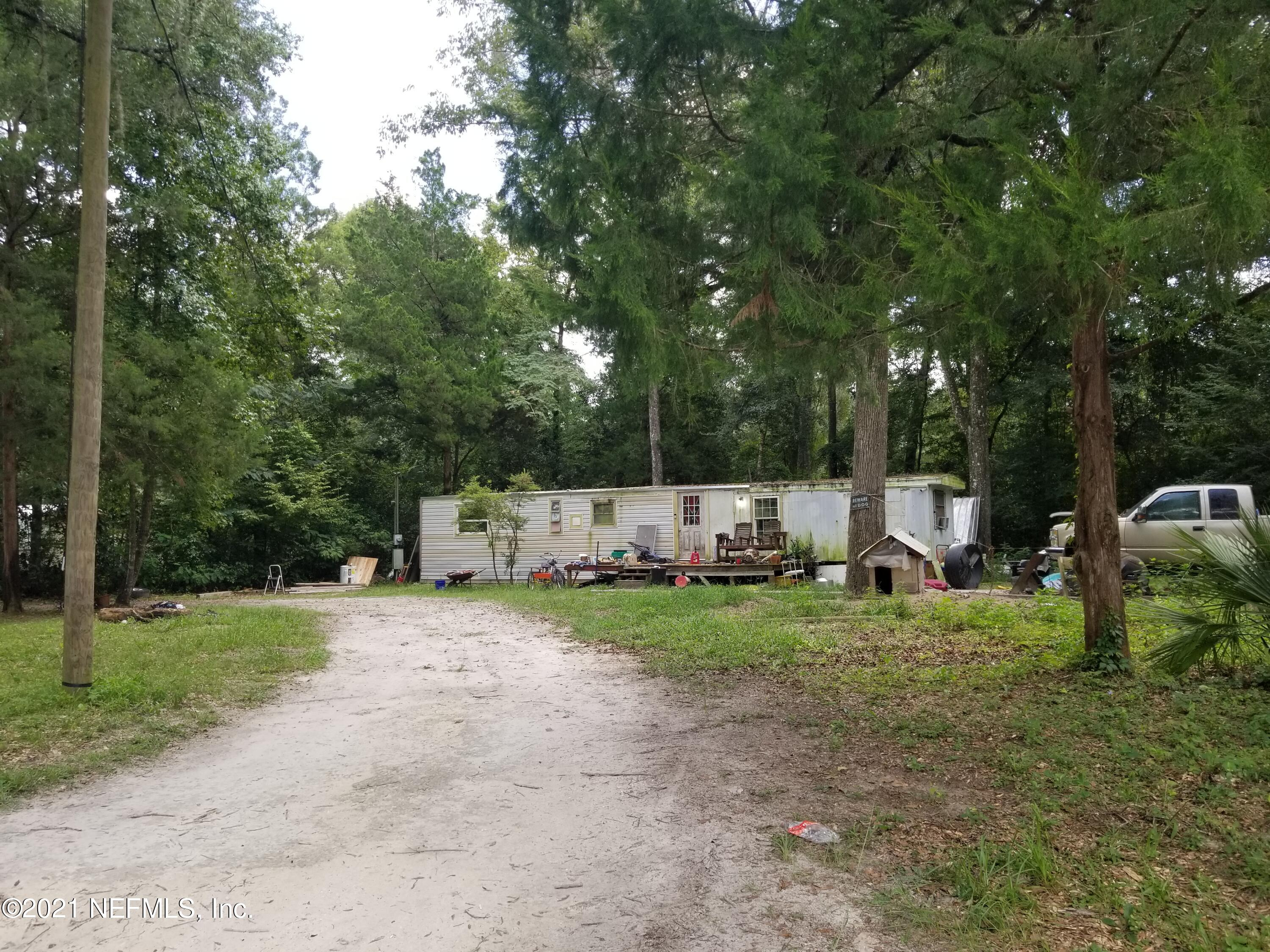 Located just 2 miles from downtown Fort White and 5 minutes to High Springs in Columbia County. This 2br/1ba mobile home sits on a  1/2 acre lot that is walking distance to the Santa Fe River with direct private ramp  access. This property is NOT located within a flood zone. Come enjoy wonderful neighbors and world renowned springs and rivers! The adjacent property (268 SW Memorial Dr is also available).