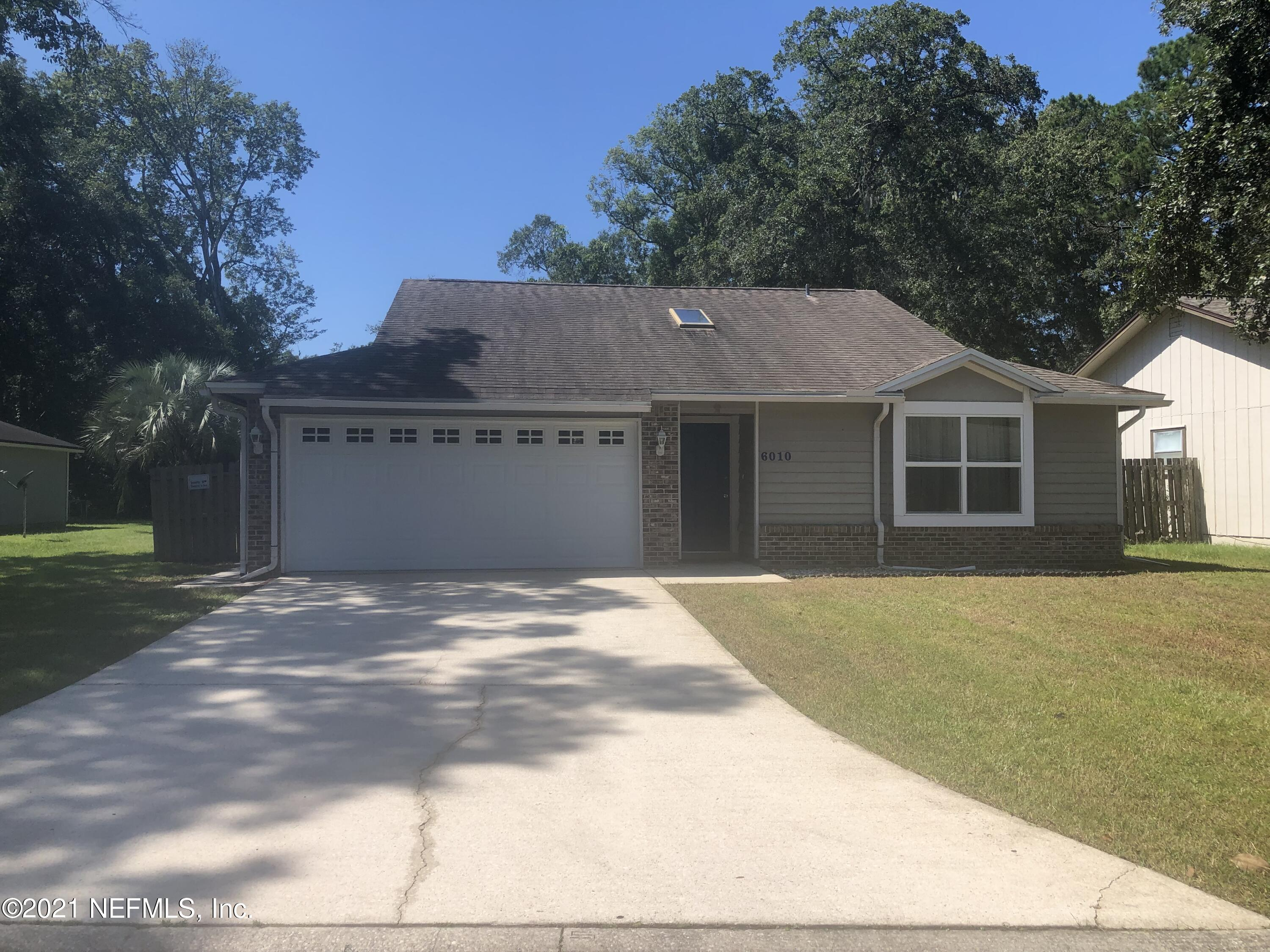 OPEN HOUSE SAT 10/23 from 2:00 to 4:00 pm. Bring your buyers to see this house that is READY TO MOVE IN! Beautiful 3 bedroom / 2 bathroom single family home with oversize lot and no HOA. Large family room with wood burning fire place, vaulted ceilings and glass enclosed porch overlooking the extensive backyard. Split bedroom design, double panel windows, 2 car garage with new motor (3 years warranty) that allows access (open/close the garage door) with the phone mobile app MyQ. Inside newly painted, outside and driveway pressure washed and carpet professionally cleaned. Located about 3 miles from NAS JAX with easy access to shopping and dinning.