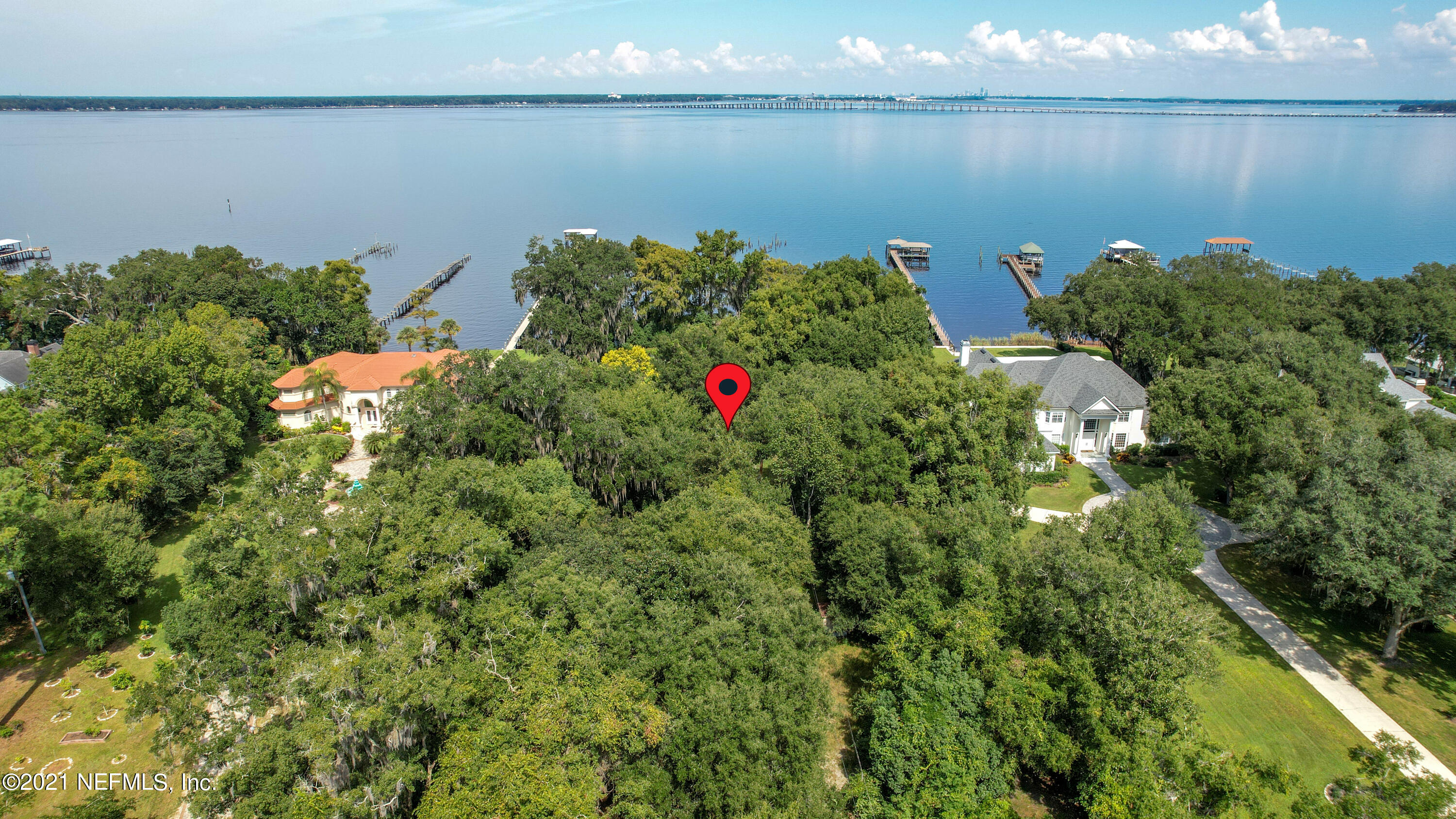 Rare Find! One of a Kind! The Value is in this Prime, Riverfront Lot in Historic, Mandarin with Close to 4 Acres (181' of frontage x 831' in depth). Exceptional Privacy, and Views Across the St Johns River, with Close Proximity to all of the Conveniences of the City. Originally Developed as a Citrus Orchard, with Existing Mandarin Orange, Lemon & Grapefruit Trees. This Unique and historic home was Built in 1885 w/''Good Bones'', but will Require Major Renovation to Dwellings (home and Several outbuildings) and Dock. It would be worth the Consideration of Renovating it. Septic System Replaced a Few Years Ago.