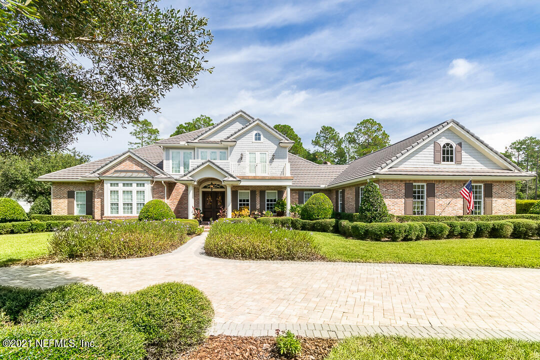 BRICK CONTRUCTION, ONE OWNER, CUSTOM BUILT HOME BY EARLE WHITEHURST HOMES IN DESIRABLE PABLO CREEK RESERVE! Master bedroom is located on the first floor as well as a very large bedroom- perfect for the in-laws!  This home includes an office, theater room, workout room, separate dining room, mud room, etc. Estate lot on .88 acres that backs up to the preserve! The kitchen includes double ovens, a warming drawer, gas cook top, two dishwashers, a wine chiller and a butlers pantry. Outside enjoy your summer kitchen that overlooks the screened in pool with spa and koi pond! Great entertaining area with pergola. Additional home features include a 15K generator, a 500 gallon propane tank, 3 tankless water heaters, water softener, 3 fireplaces, central vacuum system, upstairs and downstairs laundry, Lutron lighting and shades, Savant Home System, Icyene Insulation and a Genie lift in the Foyer. Oversized 3 car garage with storage closets, sink and a tv. Plenty of storage and custom woodwork throughout!