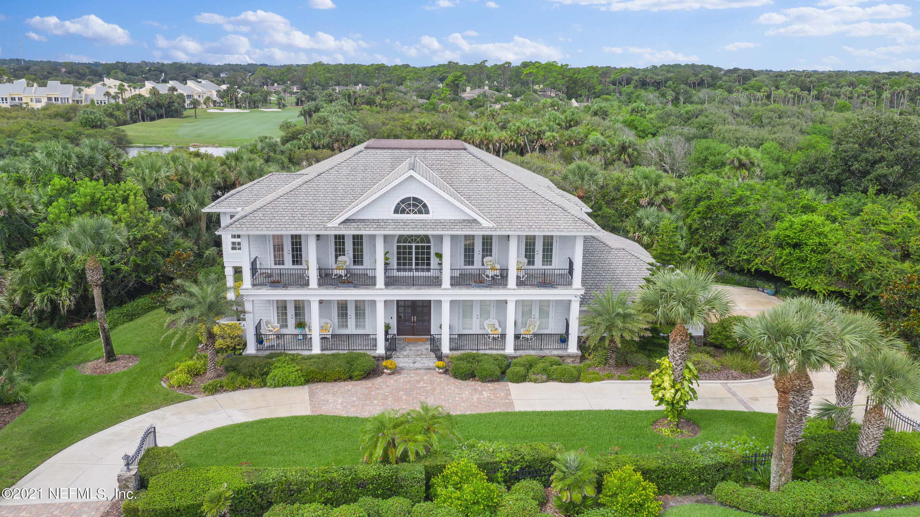 Gorgeous custom home built by Charles Collier with quality construction and top of the line finishes!  French Colonial design with living areas and primary bd suite upstairs taking full advantage of the ocean, Guana & golf course views! First floor offers two private bedroom suites, office plus a flex space that could be a family room, game room or 4th bedroom with full bath, laundry and elevator and over 1,000 sq ft garage & circular drive with gated entry! Custom woodwork throughout, spacious rooms, smooth ceilings, Carrara gold marble, top of the line appliances, wood floors and winding staircase are only a few of the high end finishes.  Four covered porches offer amazing views and relaxing entertaining spaces.  Immaculately maintained  - must see to truly appreciate the quality here!
