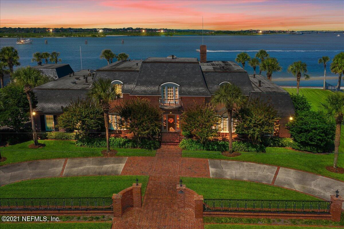 Just over the Bridge of Lions, near the tip of the Davis Shores peninsula, you'll find this elegant and stately French Baroque manor home with a slate Mansard Roof.  Boasting 215 linear ft of Intracoastal/Matanzas Bay frontage (total lot size is .81 acre), enjoy your panoramic views of Porpoise Point, Vilano Bridge, Castillos San Marcos Fort and Historic St Augustine - dolphins, birds and boaters offer ever-changing views!  Circular driveway and classic entry beckon you into the foyer, complete with checkerboard marble, gleaming wood spiral staircase and your initial introduction to the sprawling 4300+ sq ft on the main floor. So many options to entertain friends and family: open formal living room, the generous game room, the over-sized dining room, warm family room (with wet bar and temperature-controlled wine room), breakfast room and kitchen that quench and surpass every chef's dream (Viking range, Built-in fridge/freezer, warming drawer, half-moon buffet, etc)! The office also has views of the waterway.  Also downstairs are three ½ baths, steam room, walk-in shower/dressing room, laundry room, butler's pantry and storage closets. Upstairs you'll find approx. 3000 sq ft for the loft area (and Juliette balcony), the guest bedroom (with en suite bath), primary suite with enormous closet and bath. The Sitting Room (non-confirming 3rd BR) may easily be enclosed to create another primary suite with its own en suite bath, generous double closets and a spacious balcony which offers expansive views of the backyard and Bay. You must note the crown molding, wainscotting, door casings and a myriad of other wood millwork artistry/designs throughout this home!  The backyard begs you to throw lavish events and parties with a covered cabana (450 sf with summer kitchen, warm wood ceiling and plenty of room for seating), sparkling pool and hot tub (not currently connected to heat source) and lush green lawn.  The decking for the dock was damaged but report (on file) shows concre