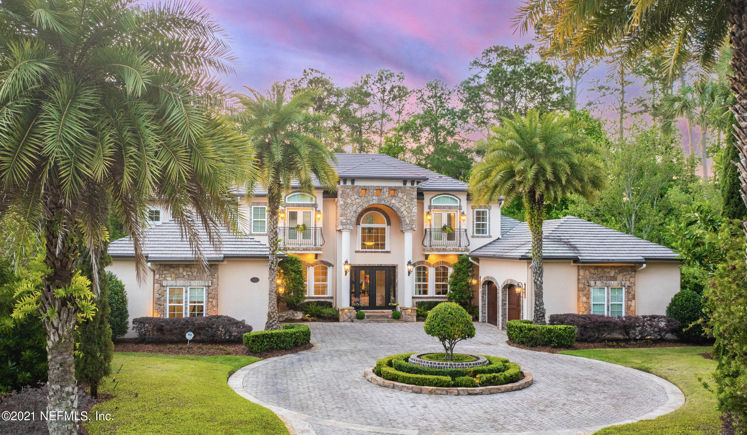 A stunning custom estate in one of the most prestigious neighborhoods in Ponte Vedra Beach! The sprawling property backs up to the 7th Fairway of the famous Stadium Course. Features you'll love -- screened in pool, spa + summer kitchen, elegant gourmet kitchen with Wolf/Kitchen Aid appliances, 4 car garage, wrap around drive, private cul-de-sac locale, and so much more.Immediately fall in love with the grand curved entry staircase, living areas with plenty of space to entertain, fully equipped wet bar, and thoughtfully designed living quarters featuring radiant heat flooring in both first floor full baths. Live just steps away from one of the most sought after courses in the country and a quick golf cart ride to putting your toes in the sand.