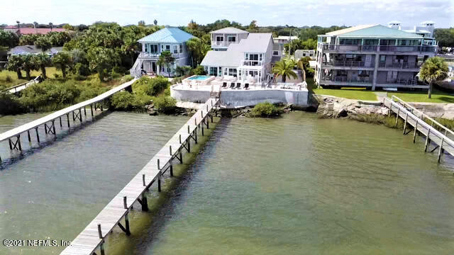 Come and see this breathtaking waterfront home with intracoastal views located on Salt Run! Take your boat out from your private dock in a no wake zone and then come back and soak in your saltwater pool. The dock can support 50'+ sport fisher!!! This property has a total of 3,640 square feet. The main house includes 5 bedrooms and 3.5 bathrooms and plenty of additional living space. The main house also includes a 2 car garage. It is beautifully remodeled with new bathrooms, new kitchen, new plumbing, and spectacular lighting and travertine flooring. This property also has a detached 3 story home with an additional 2 car garage on the ground level and then the upper two levels of living space. When you step onto the second floor you will find 2 bedrooms and a Jack and Jill bathroom. On the third story there is an open plan kitchen and living room. While on the third floor you must step out onto the deck and you will see stunning views of the ocean, the intracoastal, and the lighthouse. This is a very highly sought after area of town to live in and this home is amazing and unique. This property won't last long!