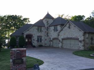 Beautiful castle like home with gorgeous setting, 3 car garage and stained drive