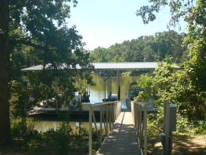 ONE OF A KIND! If you are looking for a private waterfront property ready to build your perfect home here it is! 1190' of secluded shoreline complete with new BOAT DOCK, screened in Pavilion, new 60'x 80' shop/UNFINISHED framed in 50' x 20' 2000 sq ft 2B/2B living quarters. Shop has 6'' concrete floor/radiant heat. Cedar fenced in garden area.