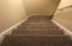 staircase to a third level with a bed and bath