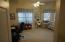 Front down stairs Bed room or C/B an Office area... with very nice windows...