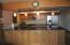 New custom cabinets w/granite counter tops. Extra storage.