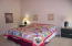 Large room with king size bed and seating areal