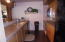 Galley style kitchen full stocked with all you need for a great meal.