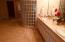 Master bath offers walk-in shower, double vanity, and jacuzzi tub.