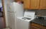 frig and washer in kitchen