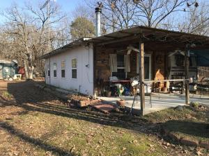 building with wood stove & porch, septic tank & electric