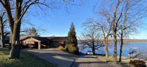 WATERFRONT HOME w/2-slip dock, encapsulated flotation and trex type decking. 3BR 3BA (3 master suites) 2 living screen room, deck and patio.