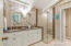 Master En Suite with Double Sink Vanity, Custom Cabinets & Walk--in Shower with seat