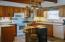 Lots of cabinet space and nature light help you enjoy your time in the kitchen.