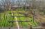 Overhead view of back yard. Cascading waterfalls, walkways, landscaping, retaining walls.