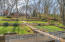 Tiered back yard with water falls and landscaping