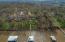 Overhead view of property, neighborhood and shoreline