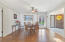 Living, sunroom, dining, bar, and kitchen feature Anderson Hickory Wood Floors