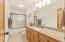 Main Floor Guest Bath has new granite countertop & new sink and fixtures.