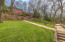 Walkways and landscaping in backyard.