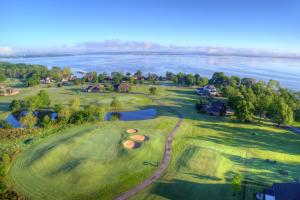 Overlooking Hole #13 - Looking north LOT #51 is directly behind the right side of the Pond!