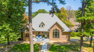 PRICE REDUCED - BEAUTIFUL GRAND LAKE HOME w/3,118 SF, 4 BR, 3 BA & oversize 2-car garage (630 SF). 2 living areas w/2 fireplaces. NEW ROOF in 2020! Master suite & guest suite on main floor living area. Guest rooms overlooking lake in lower level w/kitchenette. 528 SF deck overlooking lake - patio below. High ceilings, granite, wide plank wood floors, kitchen w/island & large pantry,