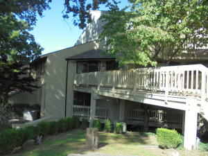 Nestled in the trees and located on the end of the building. Unit 424