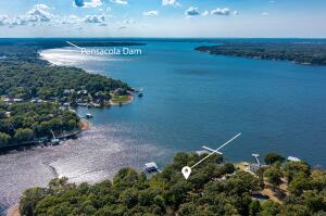 ATERFRONT HOME w/miles of lake view in front of you. 4 BR, 4 BA, 2-car covered parking, 2-slip dock w/lift & 2 PWC pads. 4 Lots w/211 FT WF. Fully furnished, freshly remodeled, and ready to move right in, right now. VRBO is currently allowed. Two(2) master suites, open living, high ceilings, zoned heat pumps, granite, stainless, gas cooking, hard surface floors, two(2) FP, & lots of deck & patio for entertaining. Boat House Bar area (24' X 31').