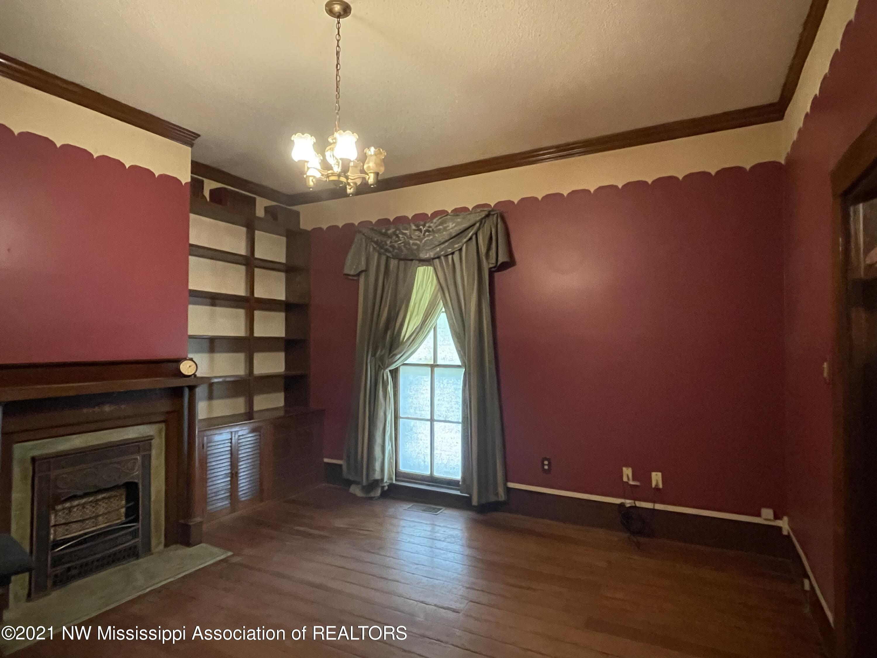 Great room with built in bookshelf