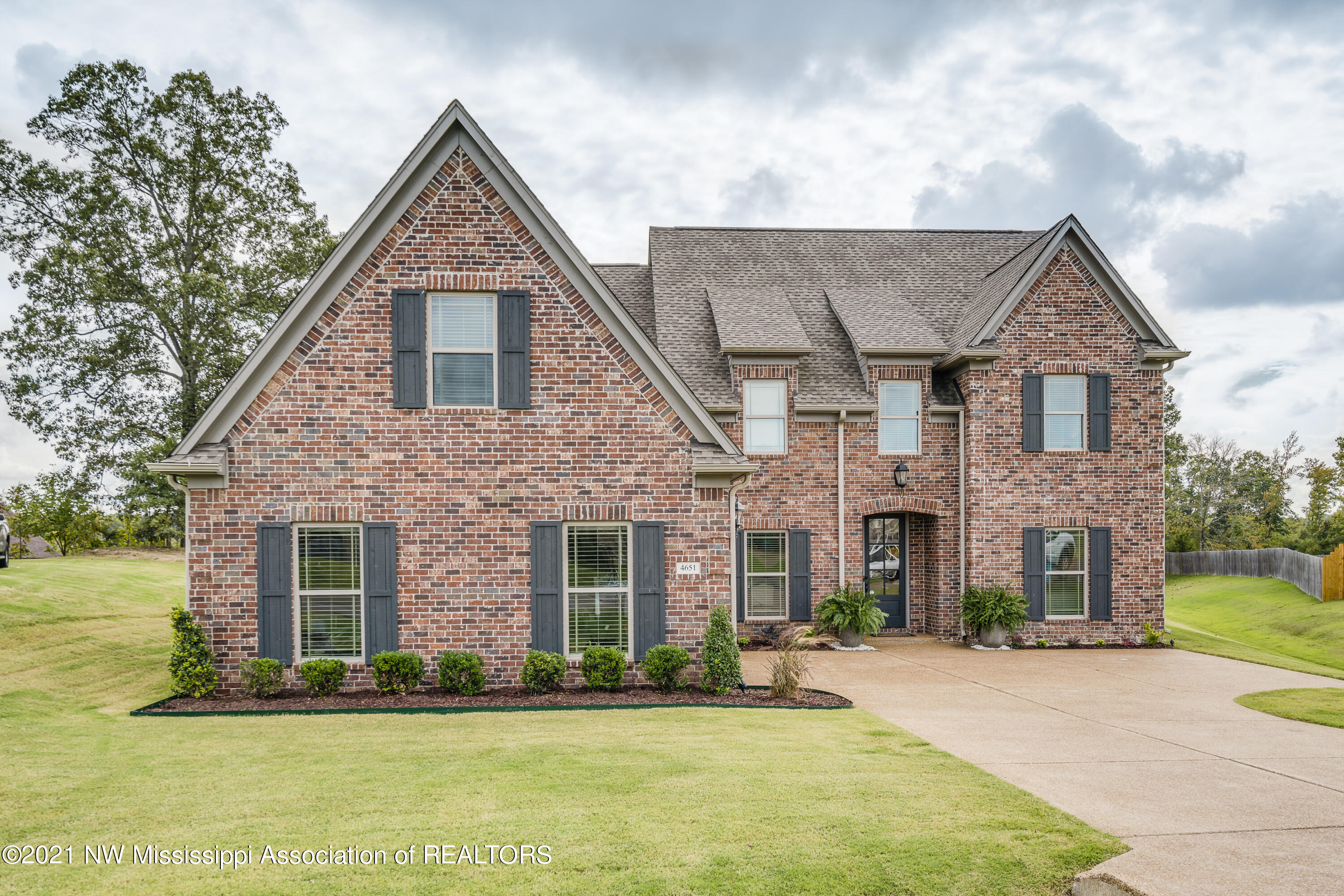 Like NEW ~ ~ Built in 2018 by DeSoto's Best Pintail Construction ~ Adorable 5 Bedroom Open and Split plan on a 3/4 Acre Cove Lot in #1 Lewisburg ~ FULL HOME AUTOMATION (Smart Home) with 2 Bedrooms, 2 Baths on First Floor; 2 Bedrooms, 2 Baths, Bonus (or BR 5) on Second Floor ~ Beautiful Nail-Down Wood Floors throughout the entire first floor (including MBR and BR2) except for tile in baths/laundry ~ Vaulted Great Room with Brick FP to ceiling surrounded by Built-In Bookshelves/cabinets, Cedar Mantle, and a triple window looking out on the Covered Porch and Huge Back Yard (big enough for a pool) ~ Open Kitchen with Center Island, Upgraded Granite, Farm Sink, Double Convection Ovens, Samsung Fridge, Custom Decorative Vent Hood Gas Cook-Top, Pot-Filler, Under cabinet lighting, walk-in pantry and a large Breakfast Area with Built-In Granite Desk with upper/lower cabinets ~ Master on the rear with wood floors, nook, recessed lighting, 2 windows, and a spa-like bath with Soaker Tub, Dual Shower Heads, 2 Granite Vanities, Make-Up Station and a large walk-in closet ~ Bedroom 2 is on opposite side of house on the first floor with wood floors and next to Bath 2 with granite vanity and tile shower ~ Mud Area with cubbies just off the Garage Entry and Laundry with built-in cabinets, hanging rod, and granite folding counter ~ Upstairs find large Bedrooms 3, 4 and 2 full bathrooms (Bath 4 is private to Bedroom 4) plus a Multi-Purpose Bonus Room ~ Outside find a great covered porch with Ceiling Fan, Outdoor TV overlooking a large back yard ~ Additional Features:  Shaker Doors, Wood-Tread Stairs, Tankless Water Heater, Walk-In floored attic / expandable area, Low E Vinyl Windows, Smooth Ceilings, Blinds, All Bedrooms feature: Ceiling Fans and Walk-In Closets, Crown Molding on first floor, Custom Upgraded Lighting, Soft-Close Drawers, Power Blinds, Full Home Automation controls Lights, Lamps, 6 cameras, Exterior Security Lighting, Soffit Down Lights, 2 Thermostats, and 8 EcoBee Tempe